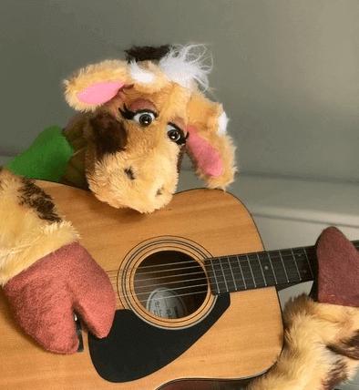 Harold practising guitar