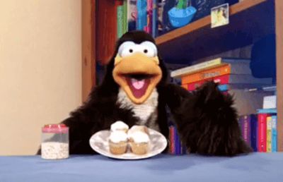 Derek the Penguin with some cupcakes