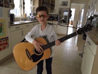 Ethan learning to play the guitar