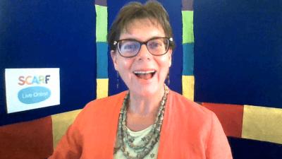 Educator smiling as she delivers SCARF Live Online workshop