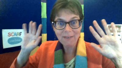 Educator waving as she delivers a SCARF Live Online workshop