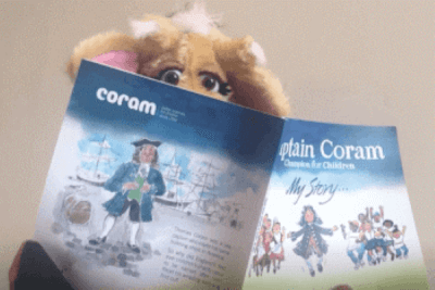 Harold the giraffe reading the book about Thomas Coram